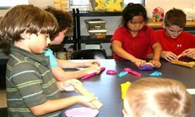 A group of young children participating in an arts and crafts activity