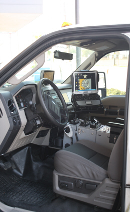 Inside the front seat of an ambulance with a laptop and GPS system