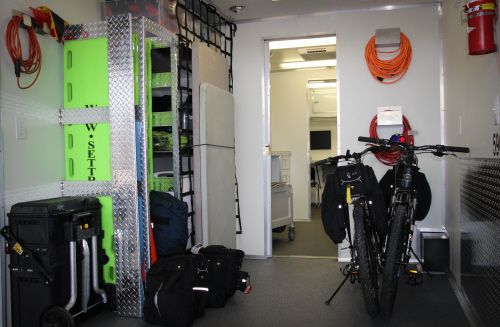 The storage area of the Special Operations trailer for bikes and field gear