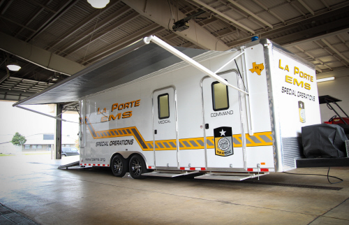 The white, EMS Special Operations trailer inside the EMS Headquarters garage