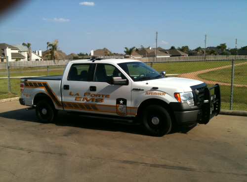 White EMS pick up truck at the baseball diamonds